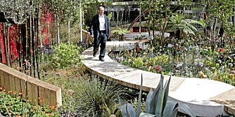 Designer Trevor Tooth walks down a path in his show garden ' The Lloyds TSB Garden', at the Chelsea Flower Show in London, Monday, May 19, 2008. (AP Photo/Sang Tan)