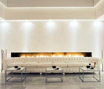 I FYR OG FLAMME: Lobbyen på Hotell Murano innbyr til peiskos.