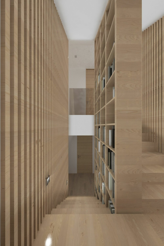 TRAPP/BIBLIOTEK: Arkitekttegnet trapp med integrert bykhylle, utført i hvitlasert heltre eik. Bokhyllen går fra gulv i første etasje til tak i andre etasje. Noen av boligene har også bokhylle på bakveggen i trappeoppgangen, slik at det oppleves som om man går inne i et bilbliotek.