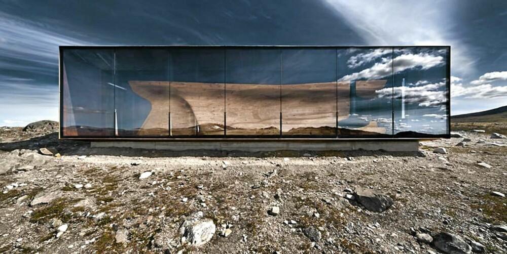 SAMLINGSSTED: Tverrfjellhytta er et unikt og robust bygg som både videreforedler tradisjonelle byggtradisjoner og å skaper et beskyttet samlingssted i fjellandskapet på Hjerkinn.