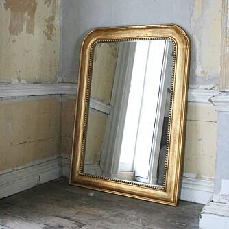 HENG OPP ET SPEIL: Speil reflekterer lyset og gjør at rommet virker større. FOTO: Graham & Green