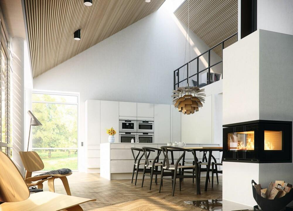 KJØKKENNÆRT: Det er praktisk å plassere spisestuen i nærheten av kjøkkenet. Her fungerer peisen Rais som en naturlig romdeler mellom kjøkken og stue.