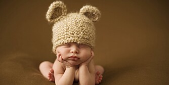 Newborn Sleeping in Knit Hat