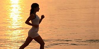 Girl running against the sunset.
