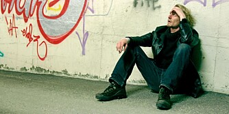 Young man sitting in an underpass