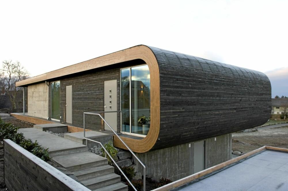 MYK MODERNISME: Den avrundete formen gir huset en sjelden karakter.
