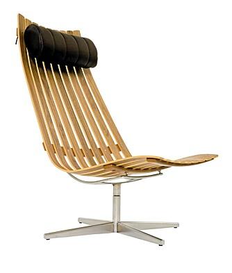 SITT NED: Easy Chair fra Scandia er skandinavisk design på sitt beste. Komfortabel, stilren og av tre.