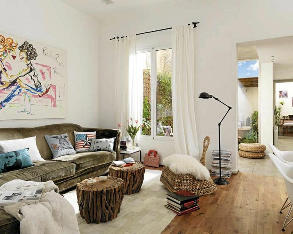 LYS OG DELIKAT: De lyse veggene fanger opp sollyset, mens kunsten på veggene gir farge og personlighet til rommet.