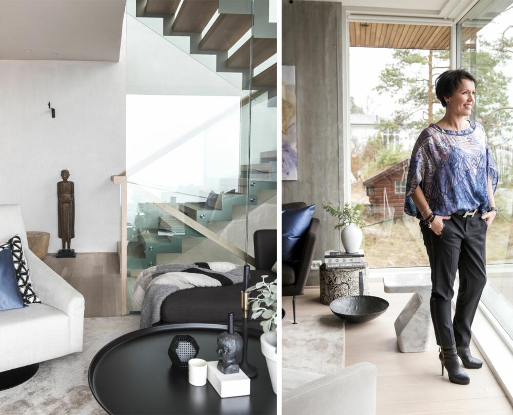 ET BLIKKFANG: Furset beskriver trappen som husets totempæl. Den ble tegnet av husets arkitekt og går over fire etasjer. Julie valgte glassvegger for å skape gjennomsyn og maksimal romfølelse.