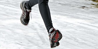 Seniors country skiers in winter on snow while jogging