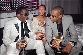 TRANGT: Beyonce sitter inneklemt mellom P. Diddy og Jay Z. Vet ikke guttaboys at hun er Queen B?