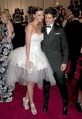 Orlando Bloom og Miranda Kerr hadde skaffet seg barnevakt for å dra på motefesten.