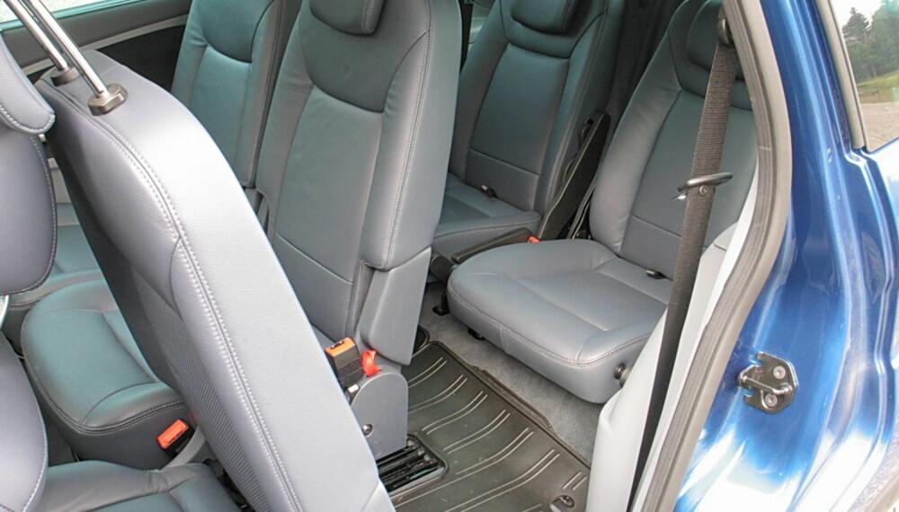 SYV SETER: Med to ekstra seter helt bakerst mister man litt bakseteplass, men gjør samtidig at man kan få med seg alle i én bil.