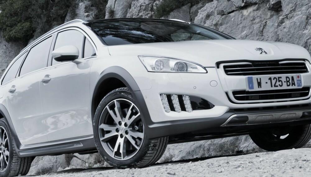 FRANSK ALLROADER: 492 000 kroner blir prisen på en godt utstyrt versjon av Peugeot 508 RXH. Foto: Jean Brice Lemal