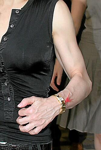 MANDIG: Flere har påpekt at Madonna mer og mer begynner å ligne på en mann i kroppen på grunn av all treningen.