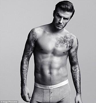 AVKLEDD: DAvid Beckham har minst 19 tatoveringer som pryder sin veltrenede kropp.