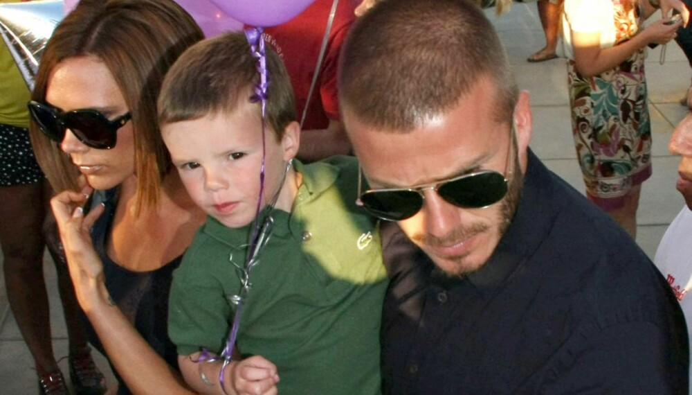 Victoria og David Beckham med sønnen Cruz