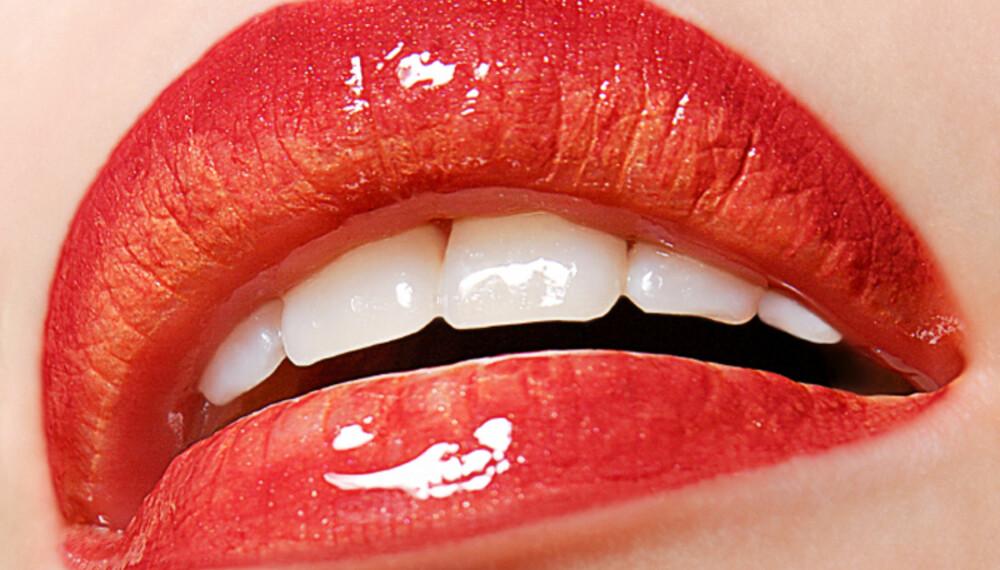 Med røde lepper er du garantert å bli lagt merke til i mengden. Men legg vekt på å finne rødfargen som passer for deg! (Foto: iStockphoto)