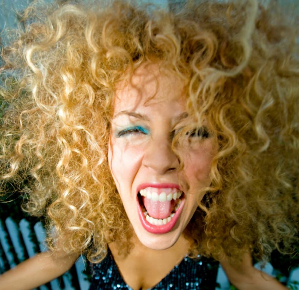 Krusete hår er ikke alltid så lett håndtere. Men følger du tipsene kan du få lekre krøller!