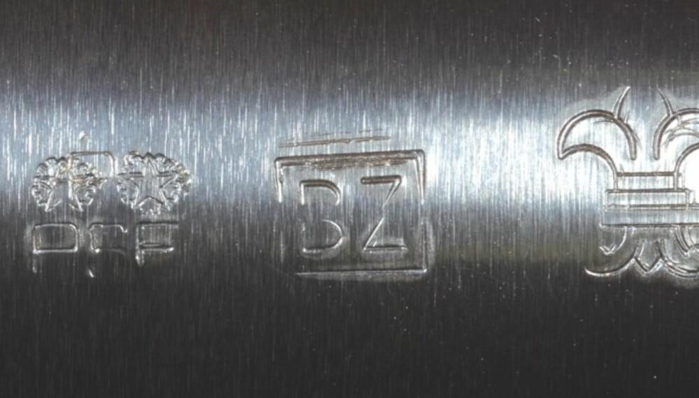 En Beretta Silver Pigeon. Merke nummer to fra venstre er Italias stempel for Magnum. Det helt til høyre er Fleur de Lys og betyr at hagla er godkjent for bruk med stålhagl av type High Performance.