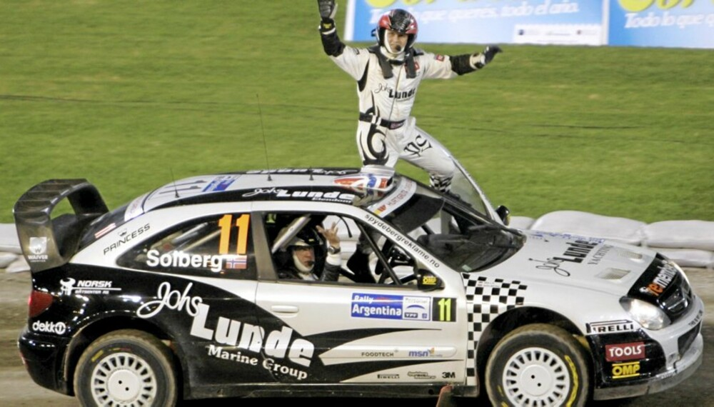 Petter Solberg of Norway, top, and his co-driver Philip Mills wave to fans from their Citroen Xsara after the first special of the WRC Argentina Rally at Cordoba Stadium in Cordoba, Argentina, Thursday, April 23, 2009. (AP Photo/Eduardo Di Baia)