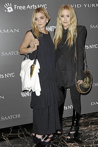 HØYE HÆLER: Olsen-tvillingene bruker alltid høyhælte sko for å se høyere ut.