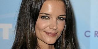 DESIGNERSPIRE: Katie Holmes følger Victoria Beckhams fotspor.