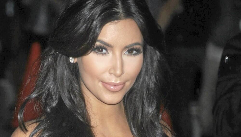 Kim Kardashian beklager hvis noen føler seg lurt etter at ekteskapet med Kris Humphries ble like kort som en av kjolene hennes.