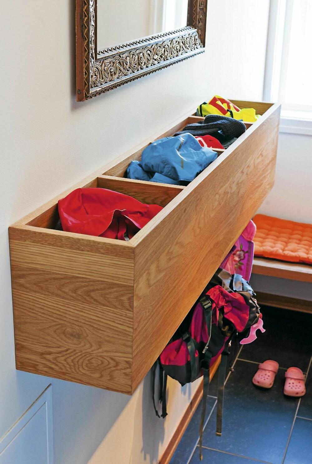 ALT I BOKS: Veggboksen har et et rom for hvert av barna i huset og en til felles bruk.