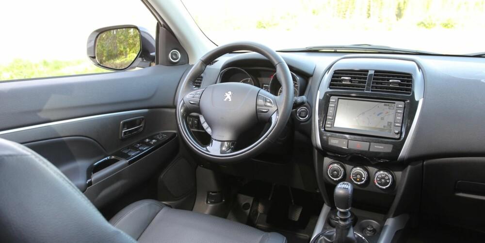 MYE UTSTYR: Med mye utstyr har Peugeot 4008 1,8 e-HDi vokst seg en klasse opp fra prisområdet rundt 350 000 kroner. FOTO: Terje Bjørnsen