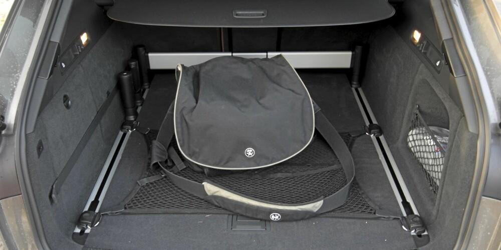NOK PLASS: Det finnes biler som gir mer plass per krone, men bagasjeromsplassen i Audi A6 Avant holder for de fleste familier.