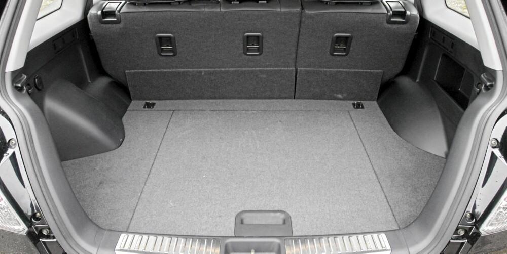PLASS: Mitsubishi Outlander er ikke av de største brukte SUV-modellene. Plassen er som en litt mindre familiestasjonsvogn.