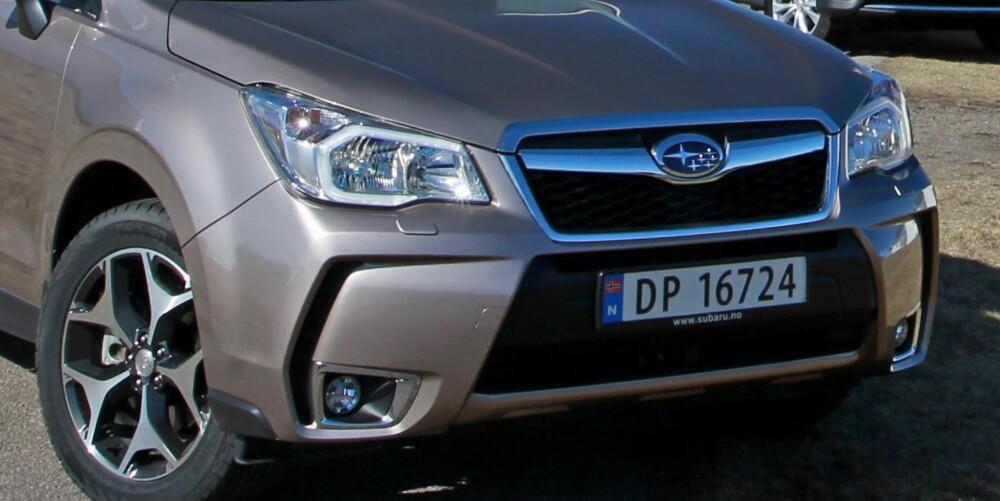 MER PYNTET: Subaru Forester har fått en mer dandy front, men er fortsatt en ganske traust bil uten særlig dill. FOTO: Petter Handeland