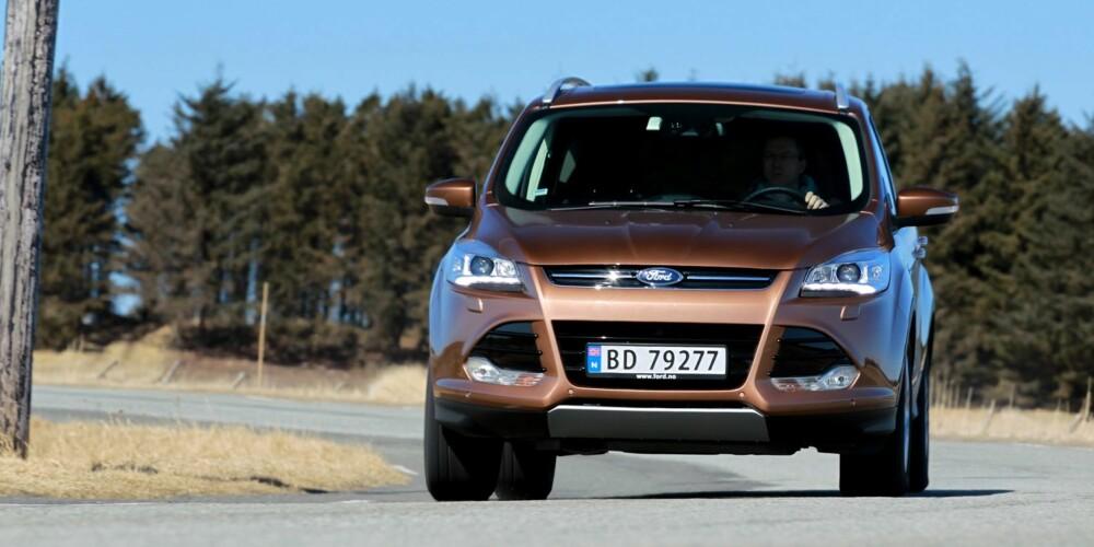 KOMFORT: Med det mykeste understellet må Ford Kuga gi seg først når den settes på tøffe prøver. Men den har best komfort med normal kjøring. FOTO: Petter Handeland