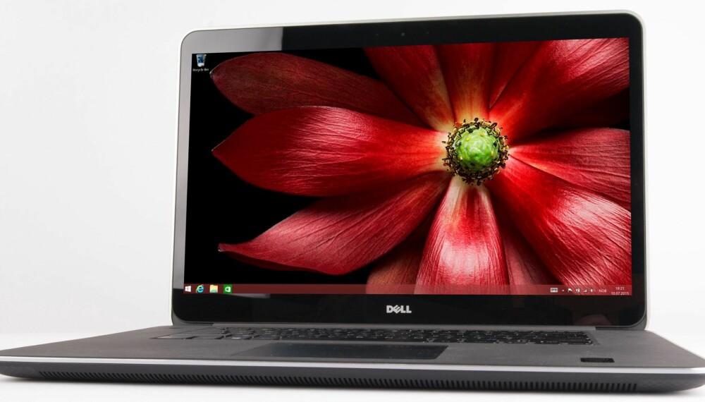 BØRSTET: Designen er klassisk og samtidig moderne siden den kombinerer aluminium og karbonfiber. Derfor er det ikke rart at Dell viderefører konseptet over flere generasjoner.