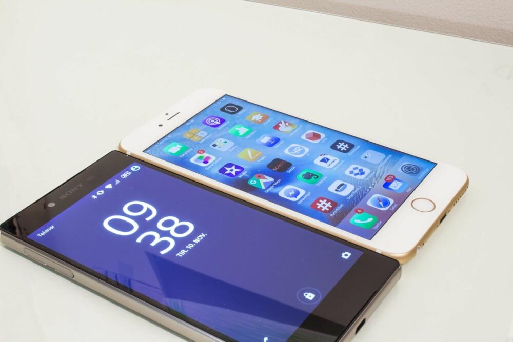 TO STORE: Både Sony Xperia Z5 Premium og iPHone 6s Plus er svære mobiler, men Z5 Premium er noen millimeter kortere.