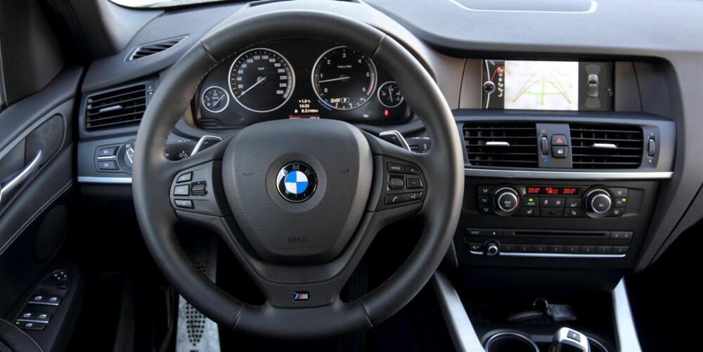 ORDEN I SAKENE: Stram regi og nøktern design preger en typisk BMW-førerplass. Det gjør også en solid kvalitetsfølelse.