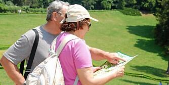senior couple reading a map
