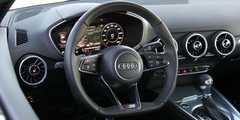 HØY KLASSE: Førermiljøet i nye TT holder høy klasse. Se hvordan Audi har lagt betjeningen av klimaanlegget og setevarmerne til luftdysene. Smart, ryddig og veldig lett å bruke.