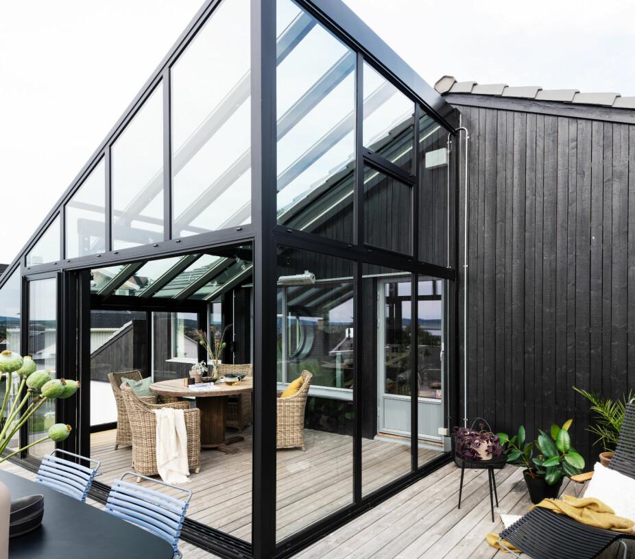 ETTER: Familien har fått et nytt rom på terrassen.